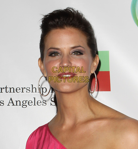 LU PARKER.40th Annivesary of Earth Day held At The JW Marriott LA Live, Los Angeles, California, USA, 22nd April 2010..portrait headshot hair up pink one shoulder hoop earrings .CAP/ADM/KB.©Kevan Brooks/AdMedia/Capital Pictures.