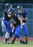 Central Bucks South's Nate Norris #39 is congratulated after scoring a touchdown against Central Bucks West in the first quarter at Central Bucks South Friday September 4, 2015 in Warrington, Pennsylvania.  (Photo by William Thomas Cain)
