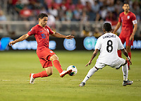 KANSAS CITY, KS - JUNE 26: Cristian Roldan #15 attacks with Marcos Sanchez #8 defending during a game between United States and Panama at Children's Mercy Park on June 26, 2019 in Kansas City, Kansas.