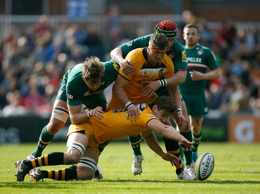 London Wasps' Sam Jones (C) is tackled by Leicester Tigers' Geoff Parling (L)<br /> <br /> Photo by Jack Phillips/CameraSport<br /> <br /> Rugby Union - Aviva Premiership - Leicester Tigers v London Wasps - Saturday 12th April 2014 - Welford Road - Leicester<br /> <br /> &copy; CameraSport - 43 Linden Ave. Countesthorpe. Leicester. England. LE8 5PG - Tel: +44 (0) 116 277 4147 - admin@camerasport.com - www.camerasport.com