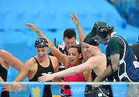 August 04, 2012..L to R: Dana Vollmer, Rebecca Soni, Missy Franklin greet Allison Schmitt as she climbs out of the pool after smashing the world record to win Women's 4x100m Medley Relay at the Aquatics Center on day eight of 2012 Olympic Games in London, United Kingdom.