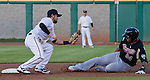Reno Aces Taylor Harbin tags out Sacramento River Cats Michael Choice during their game played on Friday night, April 12, 2013 in Reno, Nevada.