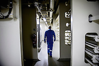 Captain Franz Holmberg walks through the Mary Maersk, the largest container ship in the world.