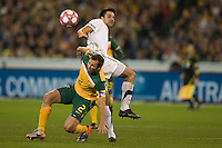 MELBOURNE, AUSTRALIA - MAY 24, 2010: Lucas Neill of the Qantas Socceroos fights for the ball with Rory Fallon of New Zealand at the FIFA World Cup farewell match between Australia and New Zealand at the Melbourne Cricket Ground, 24 May, 2010 in Melbourne, Australia. Photo by Sydney Low / www.syd-low.com