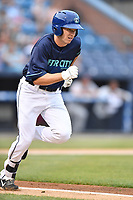 Beer City Tourists center fielder Brett Stephens (34) runs to first base during a game against the Greenville Drive at McCormick Field on May 24, 2018 in Asheville, North Carolina. The Tourists defeated the Drive 4-2. (Tony Farlow/Four Seam Images)