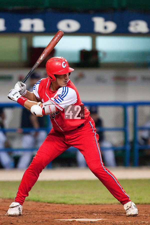 24 September 2009: Catcher Ariel Pestano of Cuba is seen at bat during the 2009 Baseball World Cup final round match won 5-3 by Team USA over Cuba, in Nettuno, Italy.