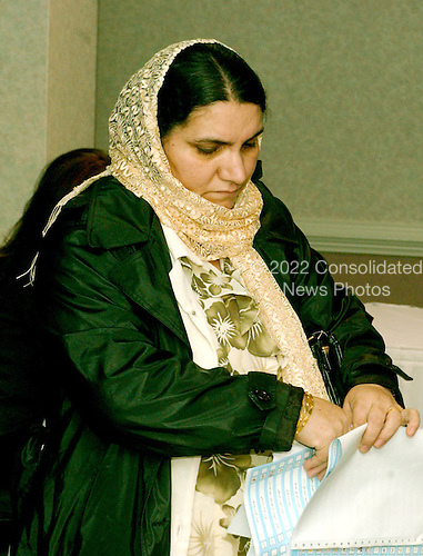 McLean, VA - December 13, 2005 -- Fatima Youssif, who emigrated to Binghamton, New York from Duhua, Iraq to escape being gassed by Saddam Hussein, holds her ballot after filling it out in the Iraqi election in McLean, Virginia on December 13, 2005. .Credit: Ron Sachs / CNP.(RESTRICTION: NO New York or New Jersey Newspapers or newspapers within a 75 mile radius of New York City)