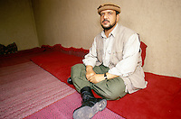 General Mohammad Quasim Fahim in is Kichim office, at the frontline against the Taleban force in Konduz. Fahim was the right hand of warlord Ahmad Shah Massoud.