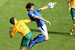 26 June 2006: Vincenzo Iaquinta (ITA) (right) plays the ball clear of Lucas Neill (AUS) (2). Italy (1st place in Group E) defeated Australia (2nd place in Group F) 1-0 at Fritz-Walter Stadion in Kaiserslautern, Germany in match 53, a Round of 16 game, in the 2006 FIFA World Cup.