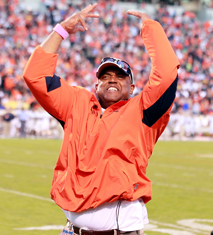 Oct. 15, 2011-Charlottesville, VA.-USA- Virginia Cavaliers head coach Mike London signals to the fans with second left on the clock during an ACC football game against the Georgia Tech at Scott Stadium. Virginia won 24-21. (Credit Image: © Andrew Shurtlef