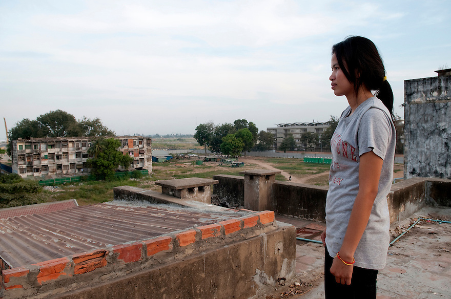 PHNOM PENH, CAMBODIA-- Khuon Lina looks out at the construction site which once housed hundreds of families in the center of Phnom Penh. Her family and 500 others were violently evicted in January of 2009. Building plans show a footprint bigger than the available site, leading many to believe that adjacent buildings will also be demolished, displacing hundreds more families. PHOTO BY JODI HILTON