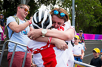 Picture by Alex Whitehead/SWpix.com - 12/04/2018 - Commonwealth Games - Cycling Mountain Bike - Nerang Mountain Bike Trails, Gold Coast, Australia - Evie Richards of England celebrates with her family after winning Silver in the Women's Cross-country race.
