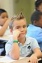 Third graders in class at the International School of Louisiana in New Orleans, Friday, Aug. 28, 2015.
