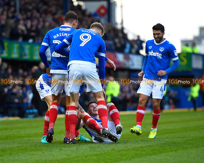 Conor Chaplin of Portsmouth (on the ground is mobbed after scoring the first goal of the match during Portsmouth vs Leyton Orient, Sky Bet EFL League 2 Football at Fratton Park on 14th January 2017