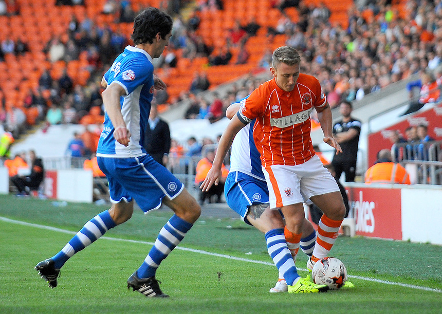Blackpool's David Ferguson is fouled by Rochdale's Donal McDermott (obscured)<br /> <br /> Photographer Kevin Barnes/CameraSport<br /> <br /> Football - The Football League Sky Bet League One - Blackpool v Rochdale - Saturday 15th August 2015 - Bloomfield Road - Blackpool<br /> <br /> &copy; CameraSport - 43 Linden Ave. Countesthorpe. Leicester. England. LE8 5PG - Tel: +44 (0) 116 277 4147 - admin@camerasport.com - www.camerasport.com