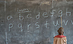 A student points to letters on the blackboard in the Loreto Primary School in Rumbek, South Sudan. The Loreto Sisters began a secondary school for girls in 2008, with students from throughout the country, but soon after added a primary in response to local community demands.