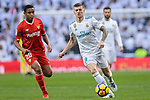 Toni Kroos of Real Madrid (R) in action against Luis Muriel of Sevilla FC (L) during La Liga 2017-18 match between Real Madrid and Sevilla FC at Santiago Bernabeu Stadium on 09 December 2017 in Madrid, Spain. Photo by Diego Souto / Power Sport Images