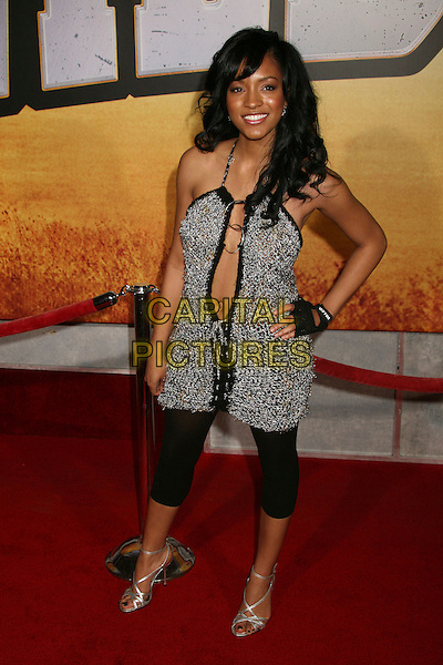 "DREW SIDORA .""Wild Hogs"" Los Angeles Premiere at the El Capitan Theatre, Hollywood, California, USA..February 27th, 2007.full length hand on  hip black grey gray knitted leggings silver shoes cut out away plunging low cut necklace gloves rings hoops .CAP/ADM/BP.©Byron Purvis/AdMedia/Capital Pictures"