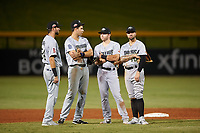 Peoria Javelinas infielders C.J. Chatham (24), Hudson Potts (35), Owen Miller (14), and J.J. Matijevic (10) during an Arizona Fall League game against the Mesa Solar Sox on September 21, 2019 at Sloan Park in Mesa, Arizona. Mesa defeated Peoria 4-1. (Zachary Lucy/Four Seam Images)