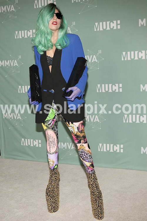 **ALL ROUND PICTURES FROM SOLARPIX.COM**                                             **SYNDICATION RIGHTS FOR UK, AUSTRALIA, DENMARK, PORTUGAL, S. AFRICA, SPAIN & DUBAI (U.A.E) & ASIA (EXCLUDING JAPAN) ONLY**  .Caption: MuchMusic Video Awards - Press Room - CTV Queen Street Headquarters - Toronto, Canada, June 19,, 2011                                                                                This pic: Lady Gaga                                                                                            JOB REF: 13601      PHZ Wong       DATE: 19_06_2011                                                            **MUST CREDIT SOLARPIX.COM OR DOUBLE FEE WILL BE CHARGED**                                                                        **MUST NOTIFY SOLARPIX OF ONLINE USAGE**                 **CALL US ON: +34 952 811 768 or LOW RATE FROM UK 0844 617 7637**
