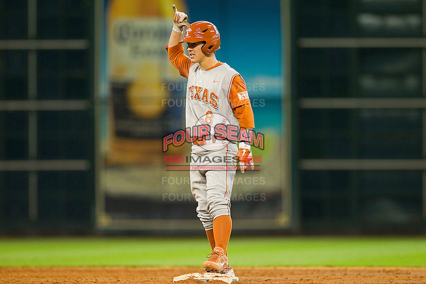 Brooks Marlow #8 of the Texas Longhorns signals to his teammates after hitting a double against the Tennessee Volunteers at Minute Maid Park on March 3, 2012 in Houston, Texas.  The Volunteers defeated the Longhorns 5-4.  Brian Westerholt / Four Seam Images
