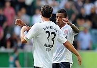 FUSSBALL   1. BUNDESLIGA   SAISON 2011/2012    2. SPIELTAG VfL Wolfsburg - FC Bayern Muenchen      13.08.2011 Luiz GUSTAVO (re) und Mario GOMEZ (li, beide Bayern) jubeln nach dem Abpfiff.