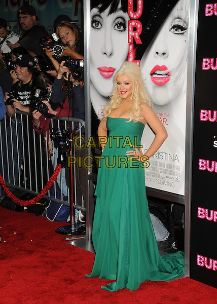 "CHRISTINA AGUILERA .""Burlesque"" Los Angeles Premiere held at Grauman's Chinese Theatre, Hollywood, California, USA, .15th November 2010..full length long maxi dress  green strapless hands on hips .CAP/ADM/BP.©Byron Purvis/AdMedia/Capital Pictures."
