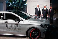 Viktor Orban (2nd R) prime minister of Hungary, Markus Schafer (L) production president and Thomas Geier (R) factory director attend an event introducing the first CLA Shooting Brake model built in the Mercedes-Benz factory in Kecskemet, (about 100 km south of Budapest), Hungary on January 20, 2015. ATTILA VOLGYI