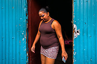 A Salvadoran sex worker leaves a room where her sexual services are offered to clients in San Salvador, El Salvador, 13 April 2018. Although prostitution is not legal in El Salvador, dozens of street sex workers, wearing provocative miniskirts, hang out in the dirty streets close to the capital's historic center. Sex workers of all ages are seen on the streets but a significant part of them are single mothers abandoned by their male partners. Due to the absence of state social programs, they often seek solutions to their economic problems in sex work. The environment of street sex business is strongly competitive and dangerous, closely tied to the criminal networks (street gangs) that demand extortion payments. Therefore, sex workers employ any tool at their disposal to struggle hard, either with their fellow workers, with violent clients or with gang members who operate in the harsh world of street prostitution.