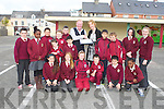 PRESENTATION: Michael Fox O'Connor who retired after 28 years as school bus driver being presented with a plaque by principal Moira Quinlan and the pupils of Moyderwell Mercy primary school, Tralee on Monday.