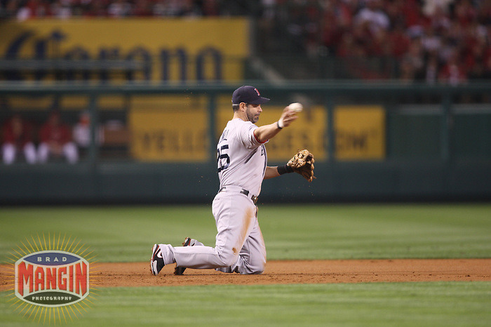ANAHEIM - OCTOBER 8:  Mike Lowell of the Boston Red Sox makes a play at third base against the Los Angeles Angels of Anaheim during Game 1 of the American League Division Series at Angel Stadium on October 8, 2009 in Anaheim, California. Photo by Brad Mangin
