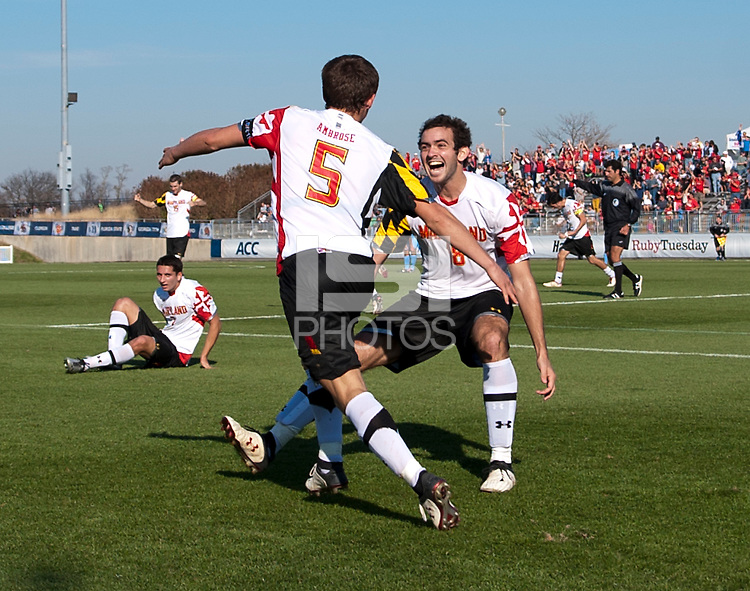 Mikey Ambrose (5) and Dakota Edwards (18) of Maryland celebrates after the game at the Maryland SoccerPlex in Germantown, MD. Maryland defeated North Carolina, 2-1,  to win the ACC men's soccer tournament.