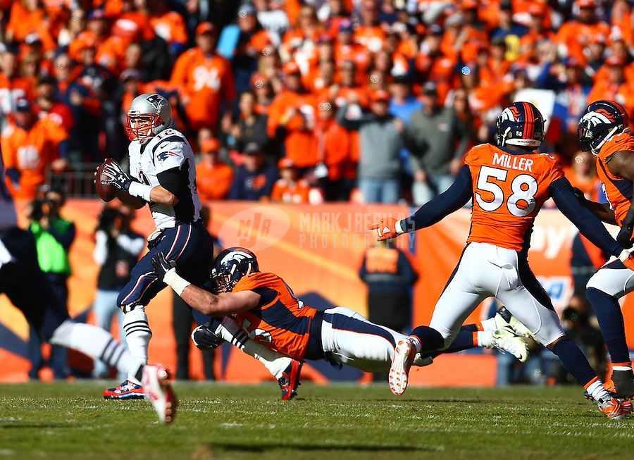 Jan 24, 2016; Denver, CO, USA; New England Patriots quarterback Tom Brady (12) against the Denver Broncos in the AFC Championship football game at Sports Authority Field at Mile High. Mandatory Credit: Mark J. Rebilas-USA TODAY Sports