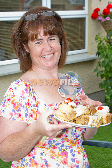 Michelle Tremarco serves up a plate of buns at the Coffee Morning in aid of the Drogheda Alzheimer's Group..Picture: Shane Maguire / www.newsfile.ie.