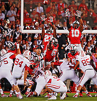 Ohio State Buckeyes defensive back Tyvis Powell (23) and Ohio State Buckeyes linebacker Ryan Shazier (10) go up high to try and block a Wisconsin field goal in the second half at Ohio Stadium on September 28, 2013.  (Chris Russell/Dispatch Photo)
