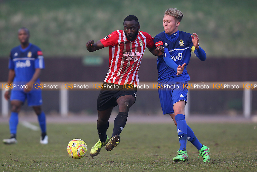 Tembeson Eyong of Hornchurch evades Liam Nash of Aveley during AFC Hornchurch vs Aveley, Ryman League Divison 1 North Football at Hornchurch Stadium on 12th March 2016