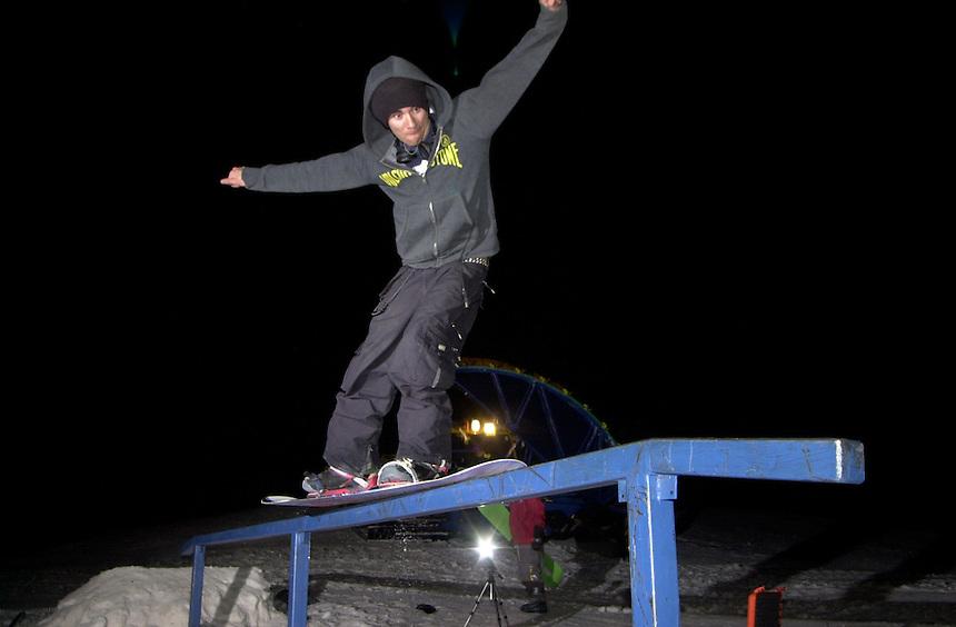 Snowboarder Bronson Frye slides a rail at Durango Mountain Resort in the snowboard park at Durango Mountain Resort in 2002.
