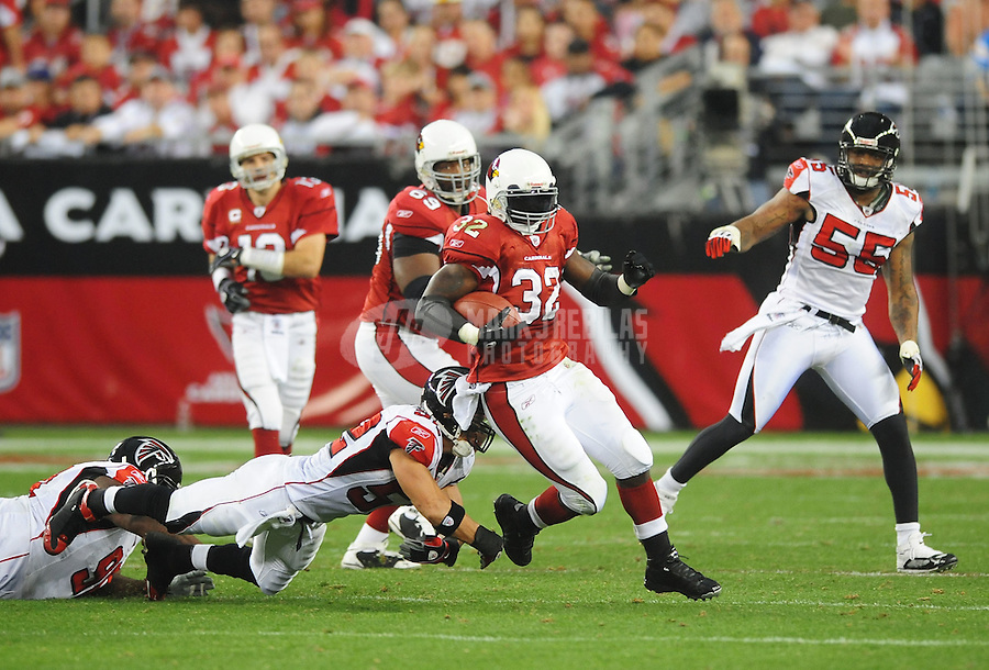 Jan. 3, 2009; Glendale, AZ, USA; Arizona Cardinals running back (32) Edgerrin James runs the ball in the third quarter against the Atlanta Falcons during the NFC Wild Card Playoff Game at University of Phoenix Stadium. The Cardinals defeated the Falcons 30-24. Mandatory Credit: Mark J. Rebilas-