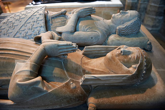 Tomb of (foreground) Marguerite d?artois (1311) and Louis of France (1319) count of Evreux and son of Philippe III le Hardi King of France.  The Gothic Cathedral Basilica of Saint Denis ( Basilique Saint-Denis ) Paris, France. A UNESCO World Heritage Site.