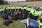 """© Joel Goodman - 07973 332324 - all rights reserved . 13/10/2010 . Brighton , UK . Activists hold an unsuccessful action against Brighton-based defence and armaments supplier , EDO MBM Technology Ltd , under the banner of """" Smash EDO """" . Photo credit : Joel Goodman"""