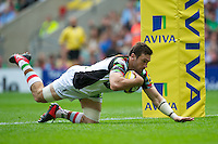 Tom Guest of Harlequins dives over to score a try during the Aviva Premiership match between London Wasps and Harlequins at Twickenham on Saturday 1st September 2012 (Photo by Rob Munro).