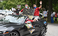 Personnel with the Lewis Automotive Group bring Rita Miller, 100, a giant birthday card Tuesday, June 23, 2020, as they participate in a surprise birthday parade in her honor. Miller is a World War II veteran that served in the Army Nurse Corp. The surprise parade included friends, family and the city of Fayetteville Fire and Police Departments. Miller also received recognition from local, state and national officials. Check out nwaonline.com/200624Daily/ and nwadg.com/photos for a photo gallery.<br />