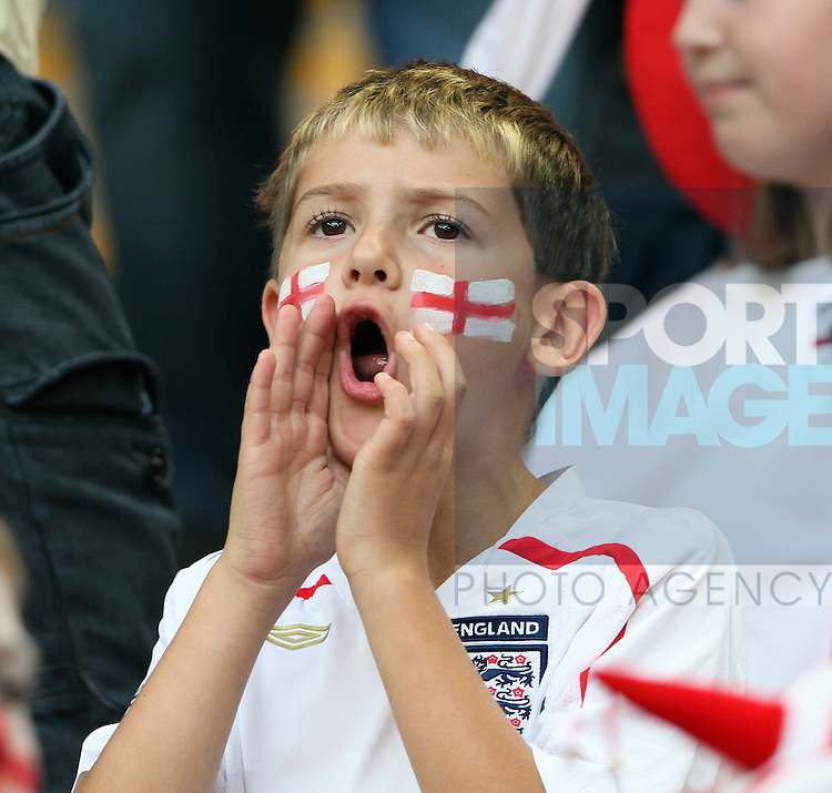 A young England fan boos the team