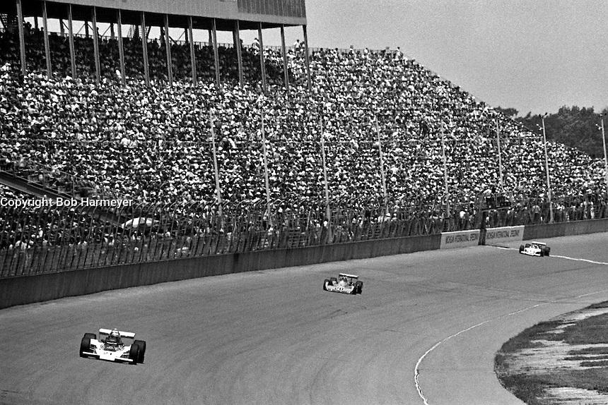 BROOKLYN, MI - SEPTEMBER 18: Al Unser drives his Parnelli VPJ6B 001/Cosworth TC toward Turn 1 during the Michigan Grand Prix IndyCar race at Michigan International Speedway near Brooklyn, Michigan, on September 18, 1976.