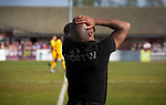 Visiting manager Darren Byfield reacts to a missed chance as Ilkeston Town (in red) hosted Walsall Wood in a Midland Football League premier division match at the New Manor Ground, Ilkeston. The home team were formed in 2017 taking the place of Ilkeston FC which had been wound up earlier that year. Watched by a crowd of 1587, their highest of the season, the match was top versus second, however, the visitors won 4-0 and replaced their hosts at the top of the division on goal difference with two matches to play
