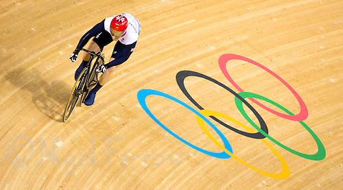 06 AUG 2012 - LONDON, GBR - Jason Kenny (GBR) of Great Britain takes a high line on the track during his Individual Sprint semi final second race against Njisane Nicholas Phillip of Trinidad and Tobago at the London 2012 Olympic Games track cycling at the Olympic Park Velodrome in Stratford, London, Great Britain .(PHOTO (C) 2012 NIGEL FARROW)