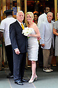 Former Governor Edwin Edwards poses with his new bride, Trina Grimes Scott, after a ceremony in the French Quarter in New Orleans, La., Friday, July 29, 2011. Edwards was recently released from prison where he served eight years on corruption charges....(AP Photo/Cheryl Gerber)