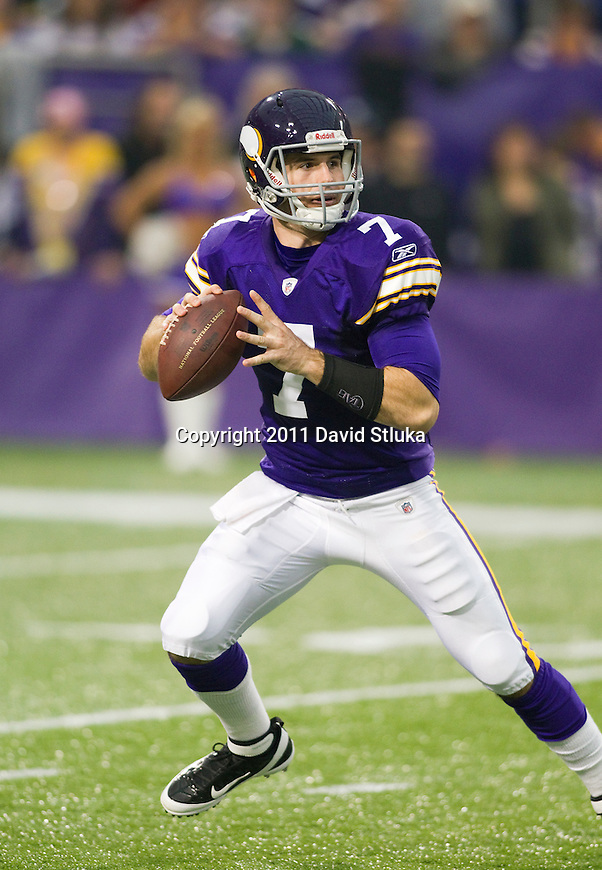 Minnesota Vikings quarterback Christian Ponder (7) looks for a receiver during a Week 7 NFL football game against the Green Bay Packers on October 23, 2011 in Minneapolis, Minnesota. The Packers won 33-27. (AP Photo/David Stluka)