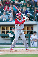 Preston Palmeiro (12) of the North Carolina State Wolfpack at bat against the Charlotte 49ers at BB&T Ballpark on March 31, 2015 in Charlotte, North Carolina.  The Wolfpack defeated the 49ers 10-6.  (Brian Westerholt/Four Seam Images)