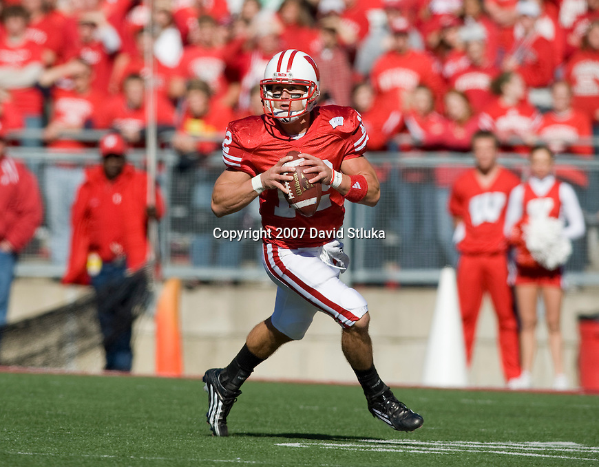 MADISON, WI - OCTOBER 27: Quarterback Tyler Donovan #12 of the Wisconsin Badgers looks for a receiver against the Indiana Hoosiers at Camp Randall Stadium on October 27, 2007 in Madison, Wisconsin. The Badgers beat the Hoosiers 33-3. (Photo by David Stluka)